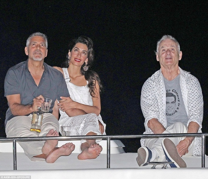 Bill Murray wearing a 'George Clooney Is A Beautiful Man' shirt while watching fireworks with George Clooney. Cloone12