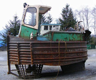 Un boomboat tout rouillé Pousse12