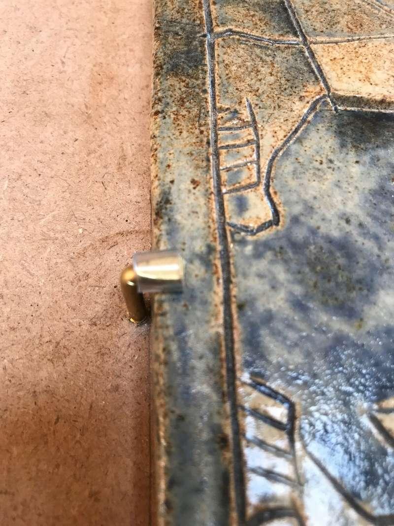 Collage d'une terre cuite sur un enduit chaux-ciment Img_0412
