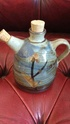 A small oil or vinegar jug with stamps  lovely colours and decoration Img_2015