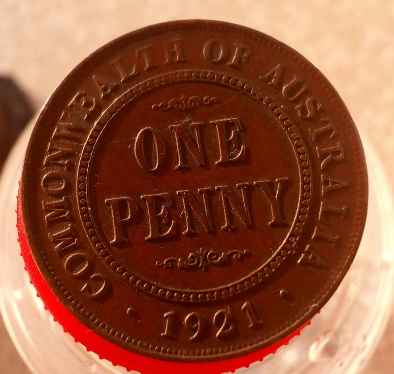 1 penique Australia 1921 duda sobre una grieta y desgaste. 1_peni11
