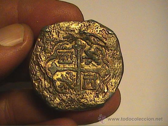 Identificación de moneda 210