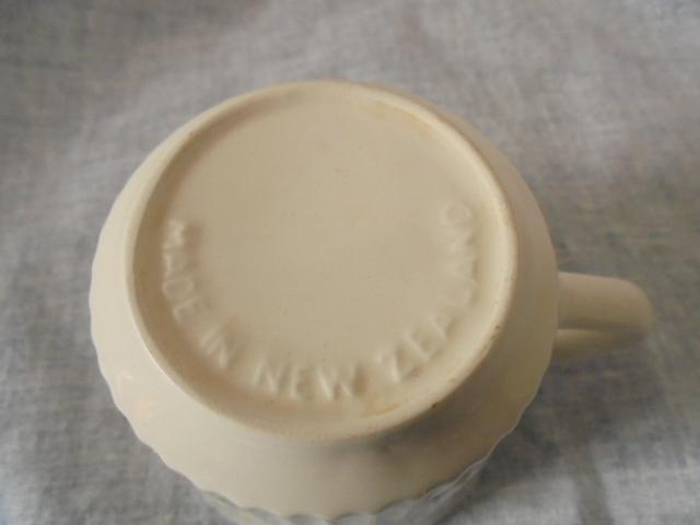 Crown Lynn cup, wine jug and sips, lidded pot Dsc04811