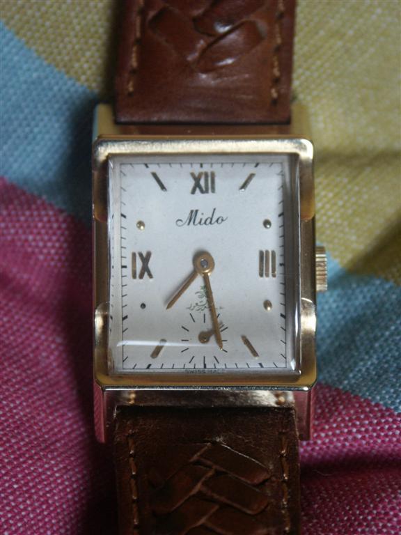 pleins feux sur les montre carré ( ou rectangulaire !) - Page 2 Mido_l11