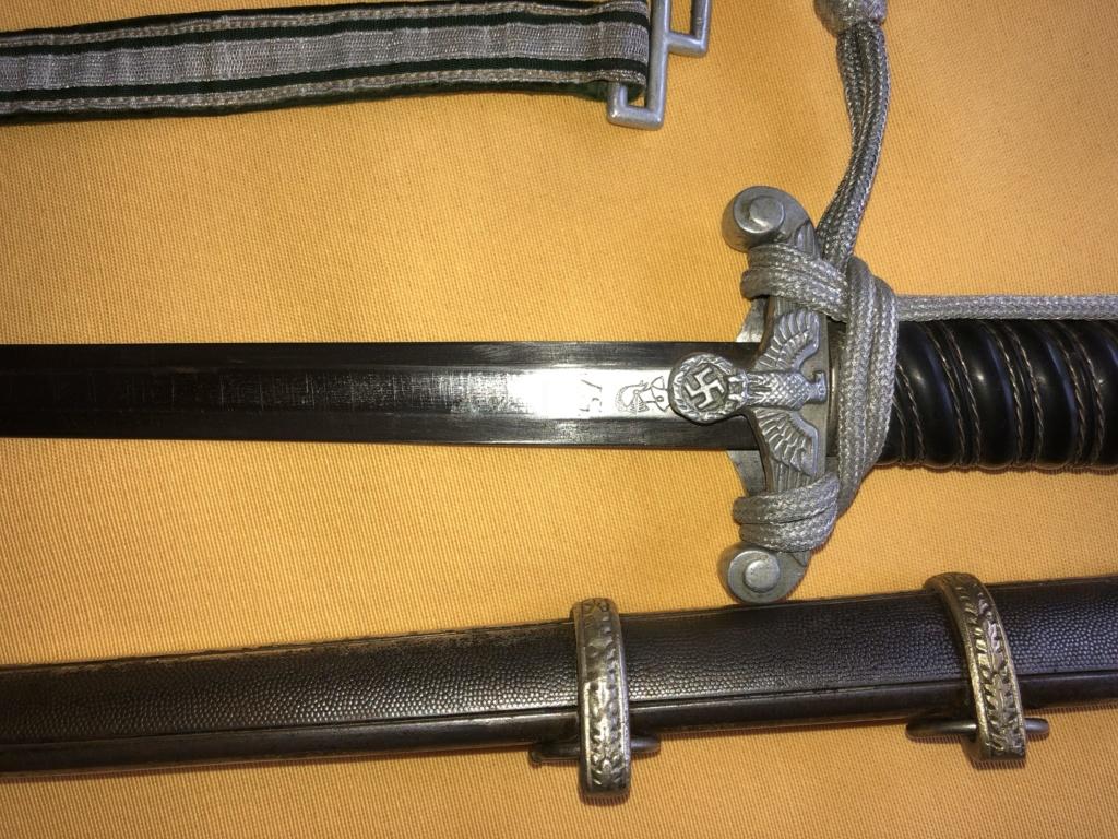 Pouvez vous m'en dire plus sur cette dague svp Image310