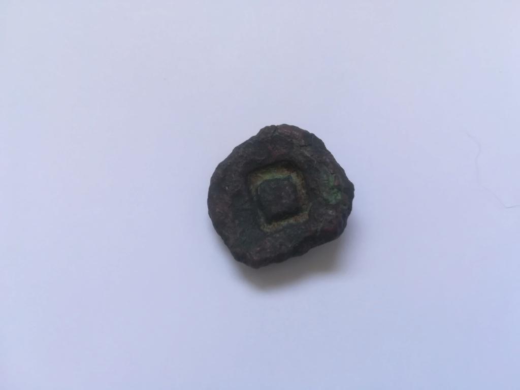 esto es una moneda griega de bronce?  Img_2010