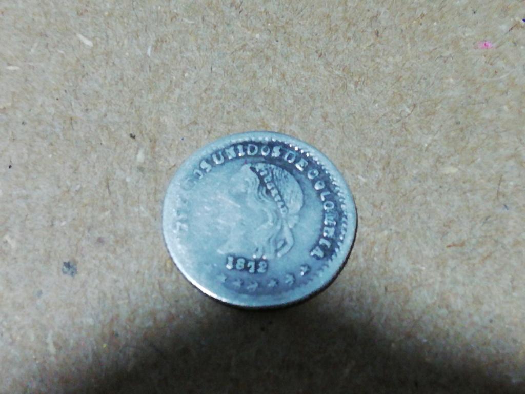 Quien me podría ayudar a identificar esta moneda Colombiana y su precio  Img_2010