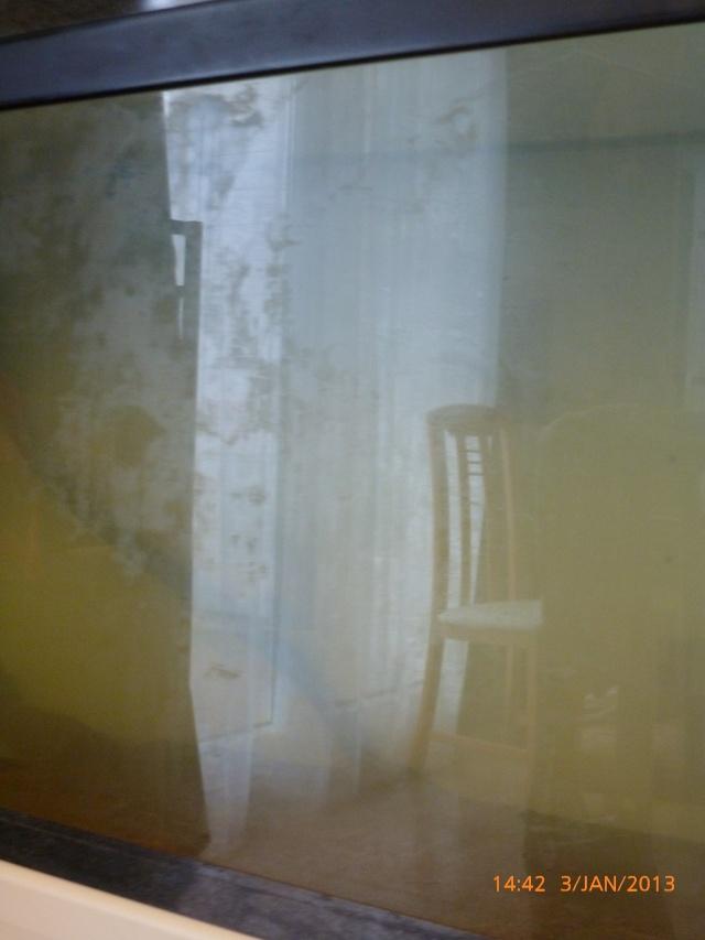 Tache sur la vitre exterieur  P1020110