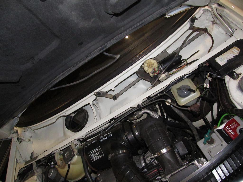 [73] 205 GTI 1L9 - 122cv - AM93 - Blanc Banquise - Page 2 Img_5320