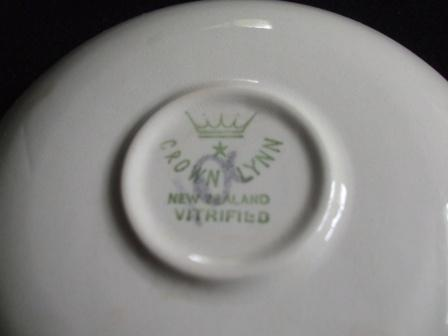 Saucer with an unknown shield monogram from Kat & Co Saucer11