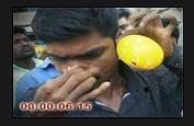 A Man blows ballon on his ear  A10