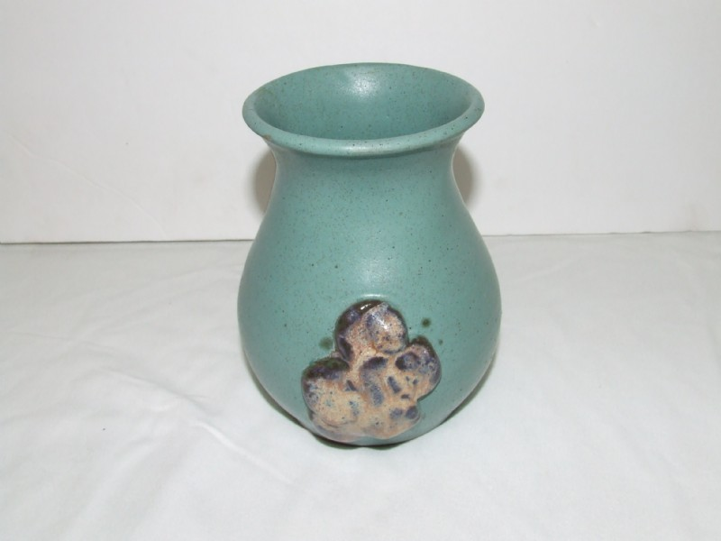 Blue vase with abstract blob shape attached to the front of vase Potter10