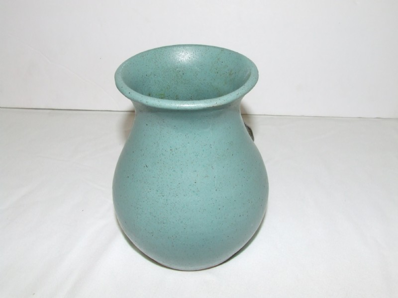 Blue vase with abstract blob shape attached to the front of vase Potter11