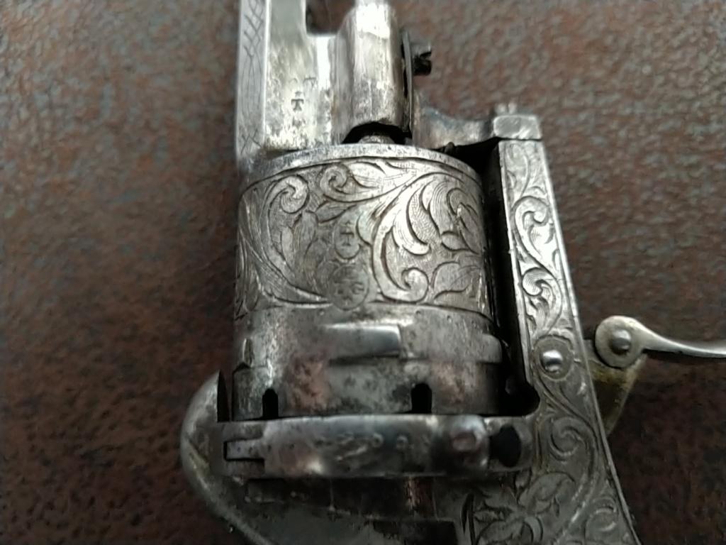 Besoin aide sur un pistolet  Img_2010