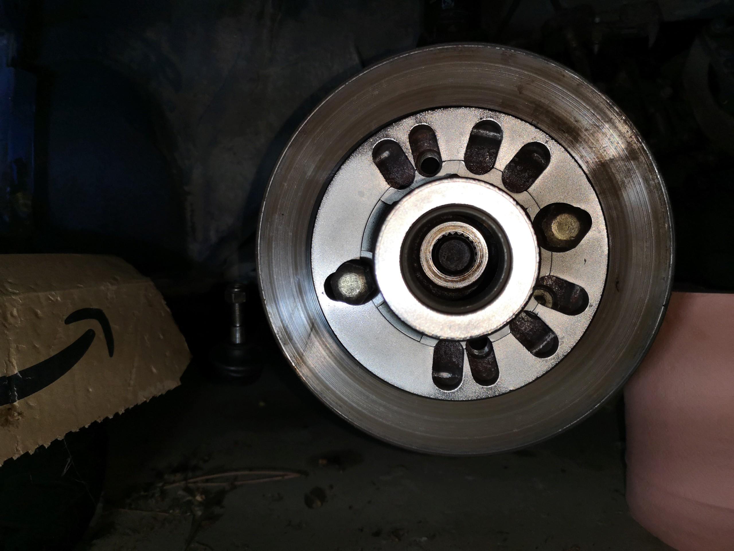 Déposer l'arbre de transmission côté roue Img_2020