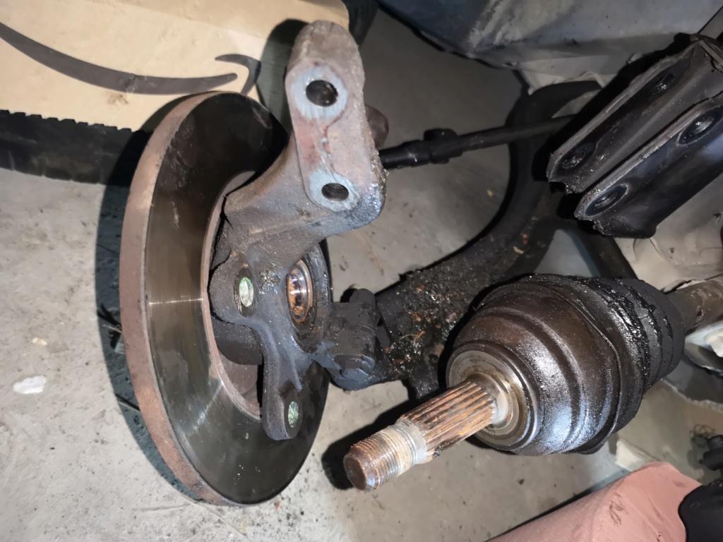 Déposer l'arbre de transmission côté roue Img_2024