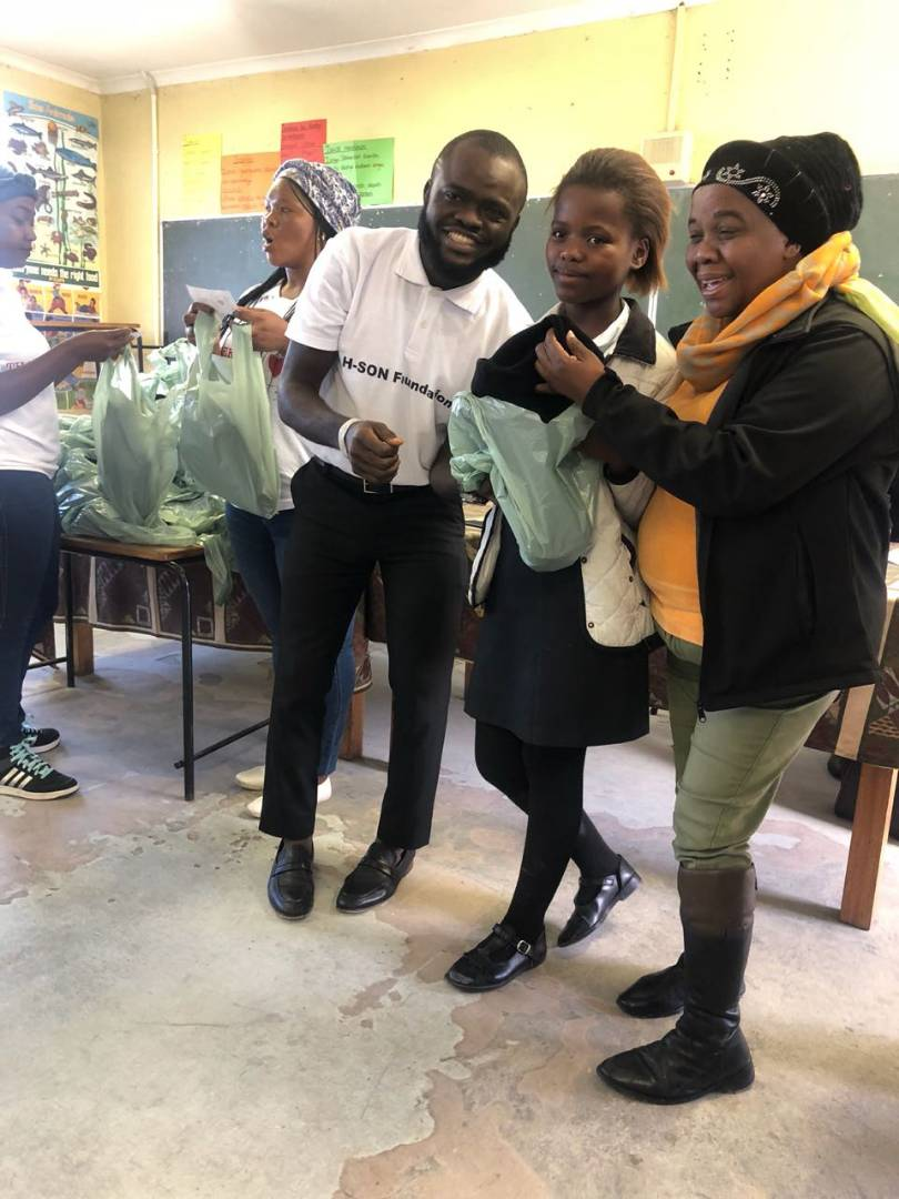 See What Nigerian Philantropist, Olatunji, Did For 300 Kids In South Africa 300k10