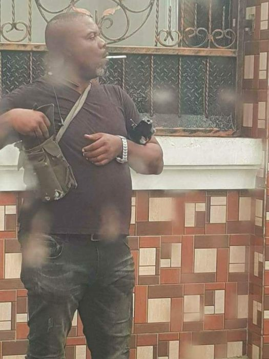 SARS Officer Spotted Smoking During Operation In Port-Harcourt (See Photos) Sarss10