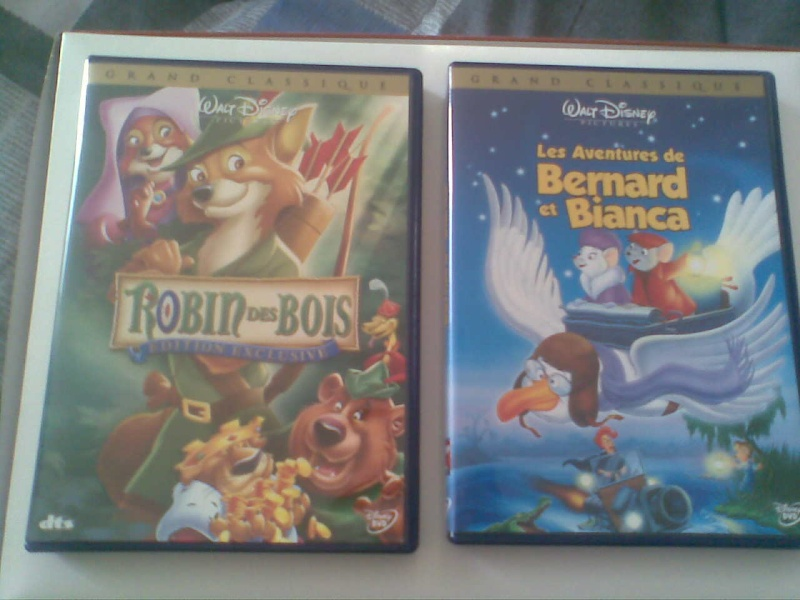 Postez les photos de votre collection de DVD et BrD Disney ! - Page 3 Photo018