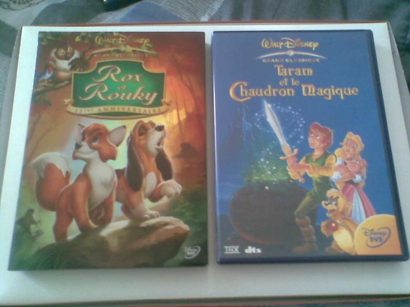 Postez les photos de votre collection de DVD et BrD Disney ! - Page 3 Photo019