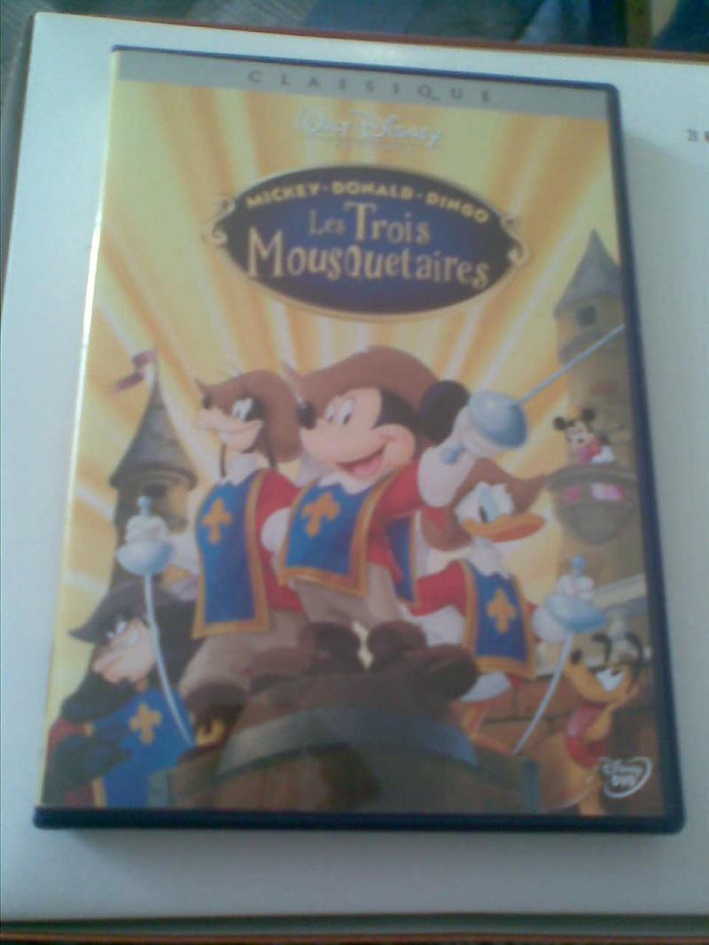 Postez les photos de votre collection de DVD et BrD Disney ! - Page 3 Photo023