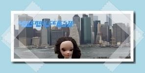 Concours de bannières n°36 :  Une poupée dans la ville ! Mc210