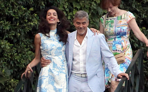 George and Amal Clooney look smitten as they don matching blue hues for date night in Lake Como July 24, 2015 G-dinn12