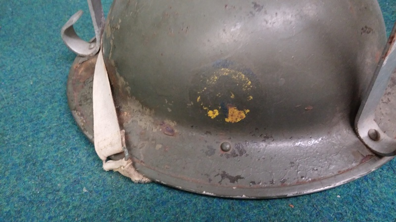 Sad fate for a couple of Canadian Mk II helmets with decals... 0611