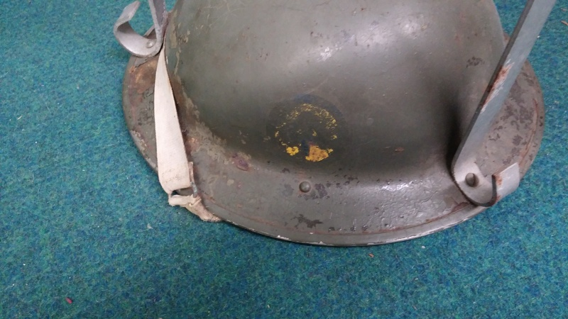 Sad fate for a couple of Canadian Mk II helmets with decals... 0710
