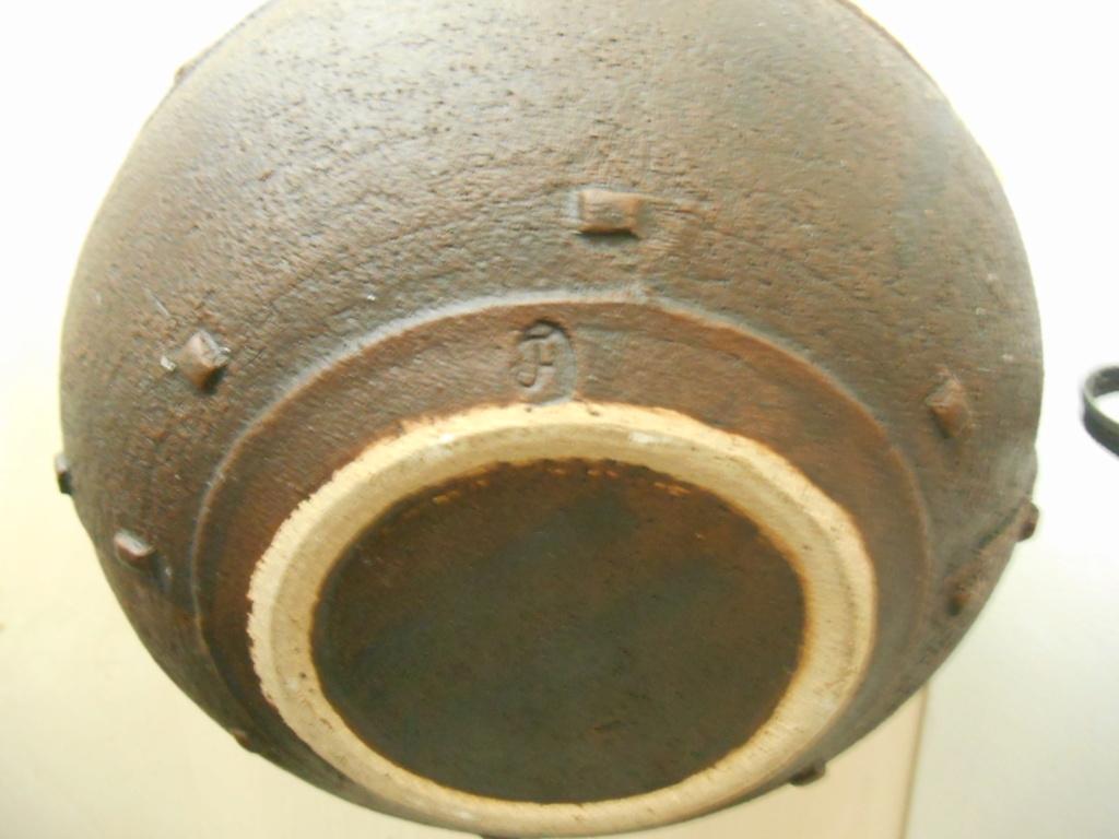 Pottery Bowl resembling a metal rivet bowl initials JH mark - maker please? Dscn6610