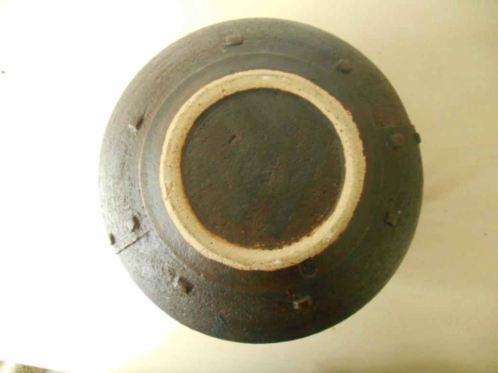 Pottery Bowl resembling a metal rivet bowl initials JH mark - maker please? Dscn6611
