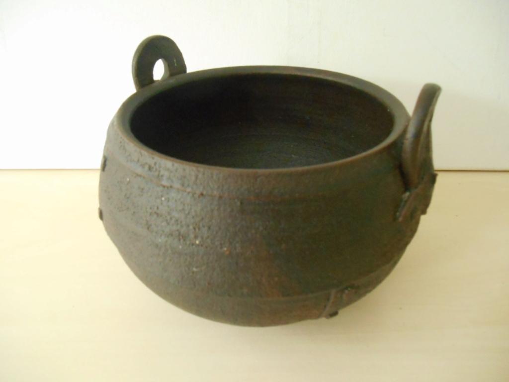 Pottery Bowl resembling a metal rivet bowl initials JH mark - maker please? Dscn6612