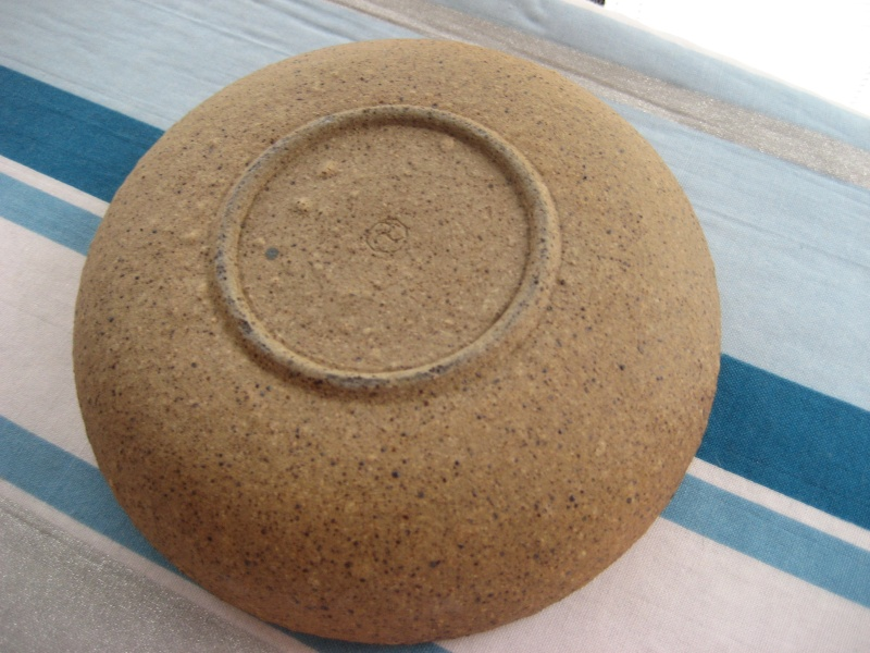 Stoneware dish, green glaze inside, mark =incised 3 arm swirl and grey dot Img_0342