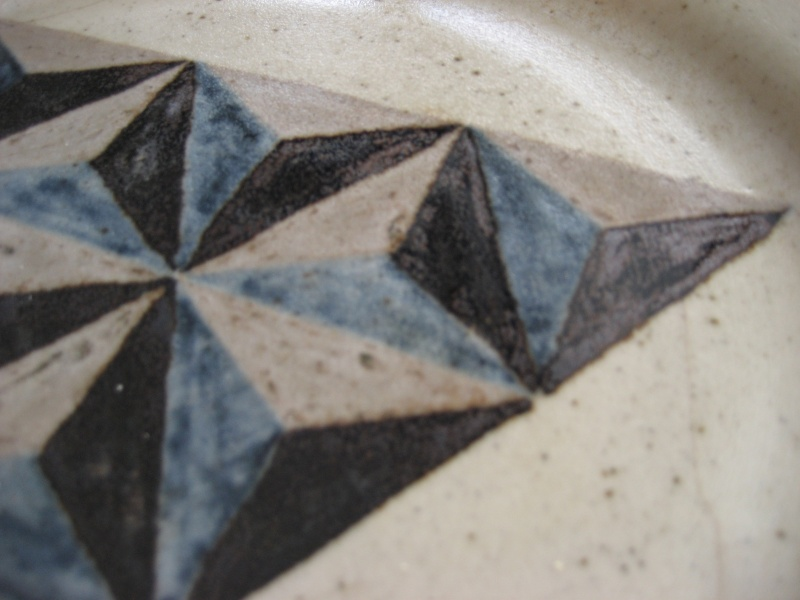 Stoneware dinner plate geometric hand painted design. W on the back. Img_0723