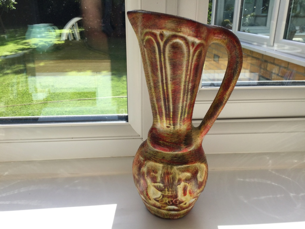 Strange foreign looking elongated jug  D96c0e10