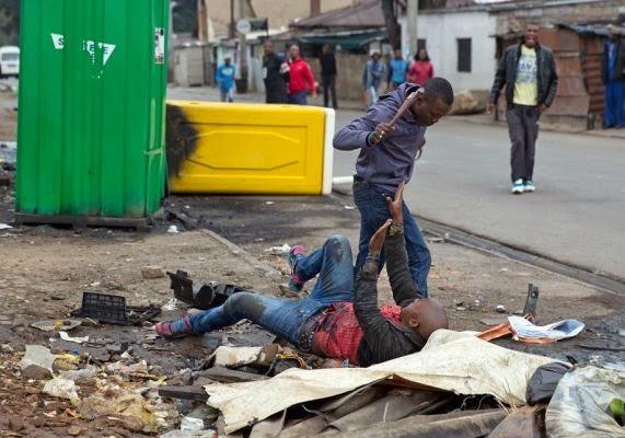 SA Xenophobic Attacks: The brutal death of Emmanuel Sithole  Xeno2b10