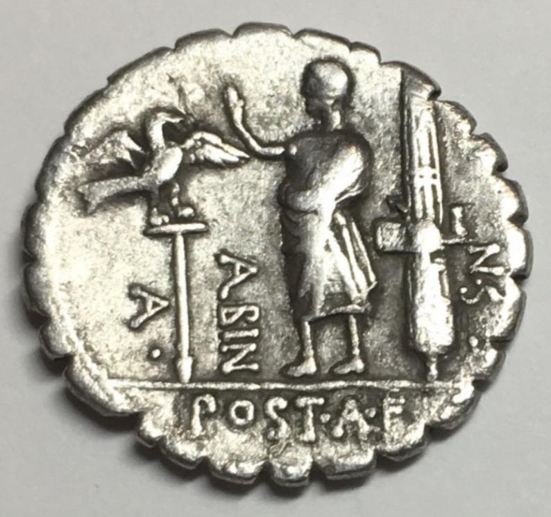 Denario serratus de la gens Postumia. A. – POST. A. F – S. N - ALBIN. Figura masculina togada a izq. Roma. 20265410
