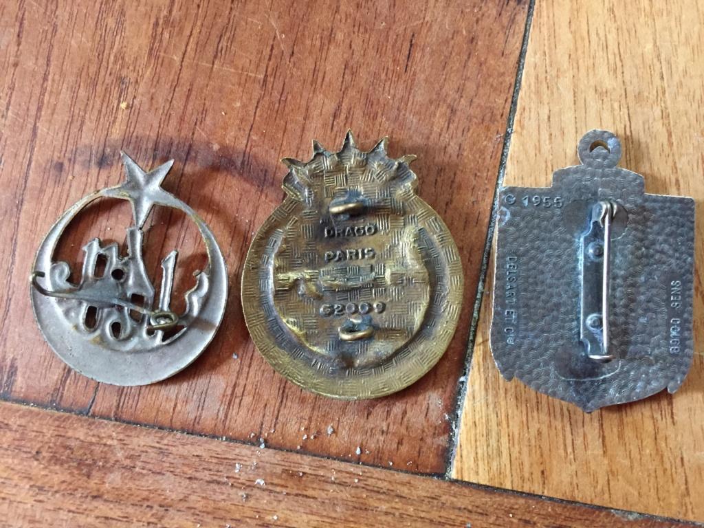Plusieurs insignes 132b9810