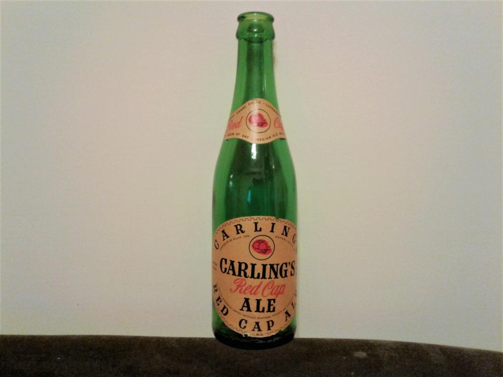 nouveauté  dans ma collection biere carling red cap,,,j'aimerai avoir info,,le prix $ et l'année de cette bouteille Carlin14
