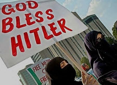 Le voile islamique n'est pas plus innocent que  le costume des K.K.K. God-bl10