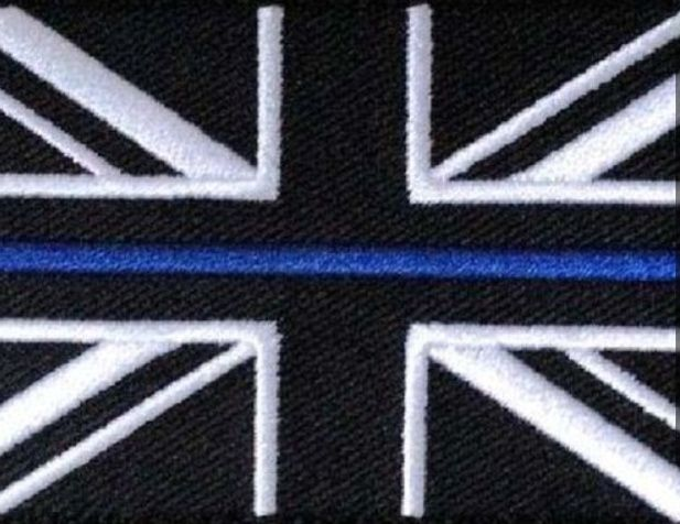 Police banned from wearing Union Jack patch in tribute to PC David Phillips who was killed in line of duty in case it causes 'offence'  Captur19