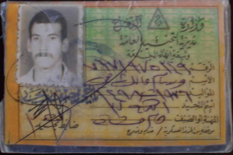 Iraqi Orders, and I.D. Cards at military show Card_210