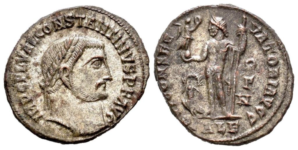 Nummus a nombre de Constantino I. IOVI CONSERVATORI AVGG. Júpiter a izq. Alexandría 111110