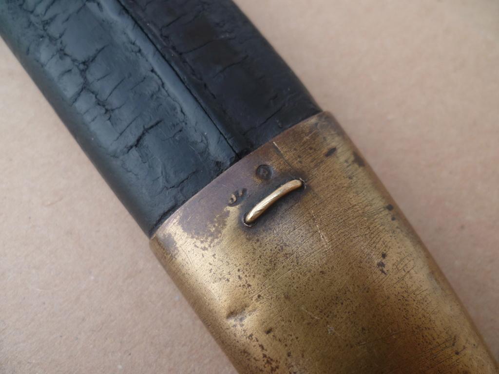 poinçon sur fourreau de sabre de marine 35410
