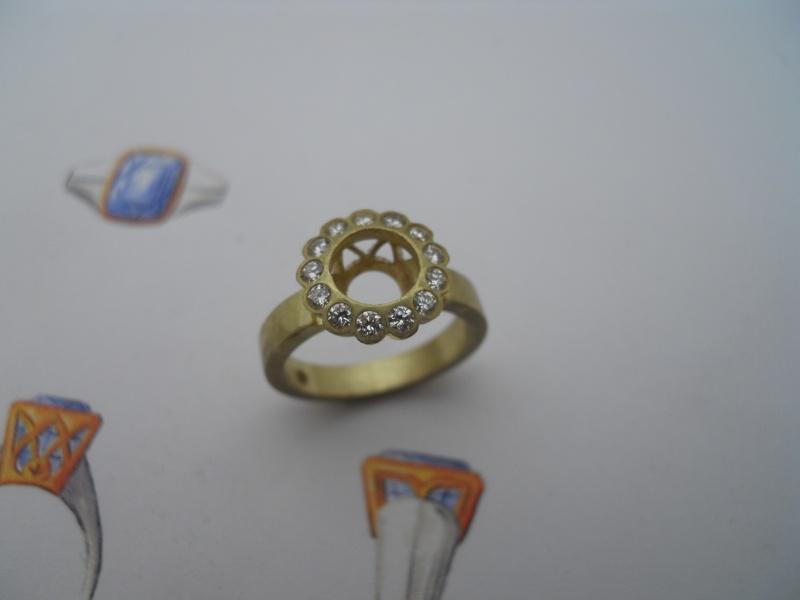 Bague entourage diamants........ 04310