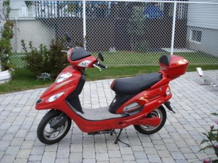 VENDU - Rack et vélos électriques (scooters) à vendre  Mopet_17
