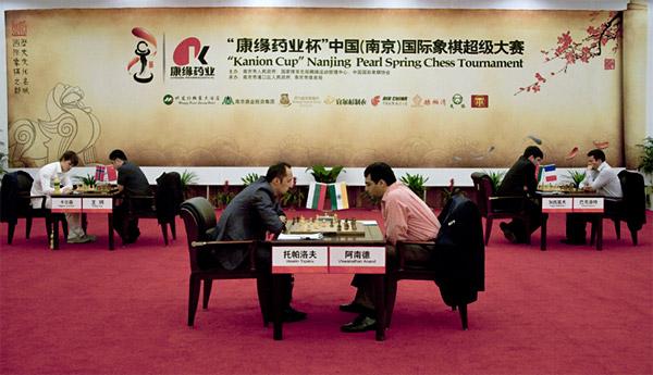 Anand beats Topalov with black Nanjin11