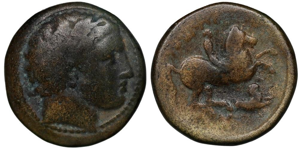 AE18 de Filipo II. ΦIΛIΠΠOY. Rey a caballo. 1565110
