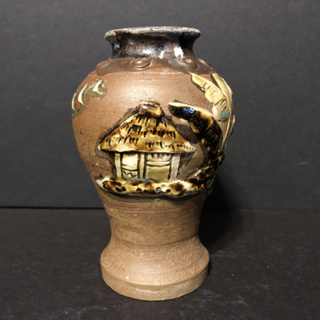 Unglazed brown vase with applied slip decoration and glazed interior  7b3a9e10