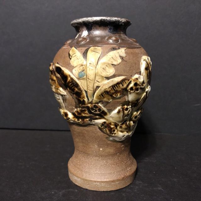 Unglazed brown vase with applied slip decoration and glazed interior  Ae9c0c10